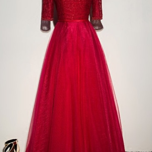 A red evening dress at a formal dress ball party
